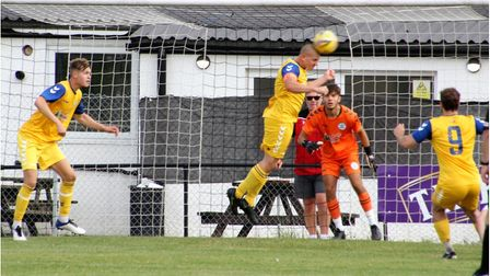 Clevedon Town's Callum Kingdon clears at Millbrook.