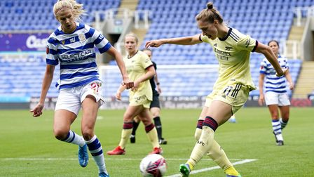 Arsenal's Vivianne Miedema (right) and Reading's Justine Vanhaevermaet battle for the ball during th