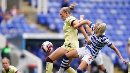 Arsenal's Frida Maanum (left) and Reading's Faye Bryson battle for the ball during the FA Women's Su