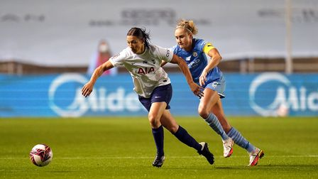 Tottenham Hotspur's Rachel Williams and Manchester City's Steph Houghton (right) battle for the ball