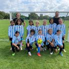Brent girls under-11s face the camera