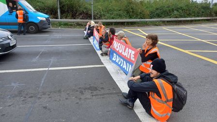 Insulate Britain campaigners on the M25.