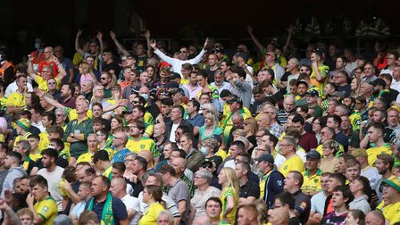 The traveling Norwich fans during the Premier League match at the Emirates Stadium, London Pictur