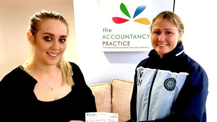 Lucy Smith, of Shepreth Spitfires, receives a cheque from Lucille Shears, ofThe Accountancy Practice in Royston.
