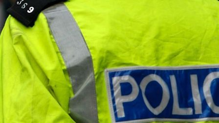 Close-up of a police officer's high visibility jacket