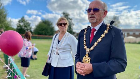 Two people dressed smartly - including Saffron Walden Mayor Cllr Richard Porch - deliver a speech outdoors