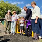 A group of people, including Mayor Cllr Richard Porch, cut a ribbon at Golden Acre, Saffron Walden