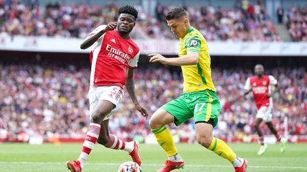 Arsenal's Thomas Partey (left) and Norwich City's Milot Rashica battle for the ball during the Premi