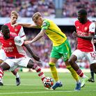 Arsenal's Nicolas Pepe (left) and Ainsley Maitland-Niles battle for the ball with Norwich City's Bra