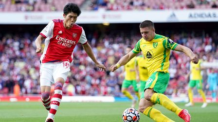 Arsenal's Takehiro Tomiyasu (left) and Norwich City's Christos Tzolis battle for the ball during the