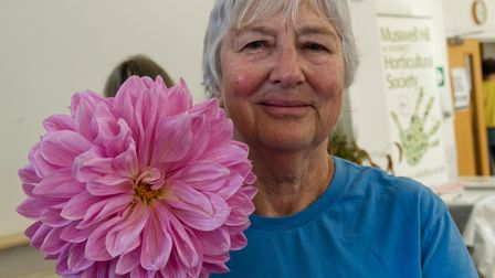 Jenny Kruss with her giant Dahlia at Muswell Hill Horticultural Society Autumn show 2021
