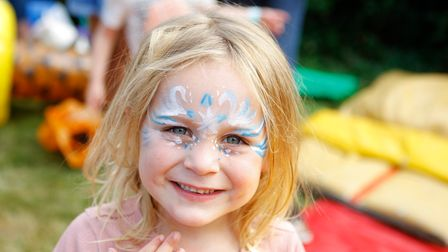 Isla Blackwell, four, with her face painted at Party in the Paddock 2021