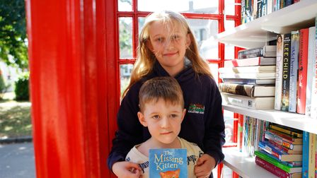 Leah,11 and Sam, five at the opening ofthe Ickleford Telephone Box Book Exchange