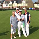 Lin Allison presenting the Jeremy Allison Cup to the winners