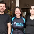 Syrah Arnold with Wisbech cafe owners ahead of Prostate Cancer UK fundraiser