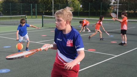 Charlie, 10, enjoying the tennis coaching at the Norwich Parks Tennis Club at Eaton Park. Picture: D