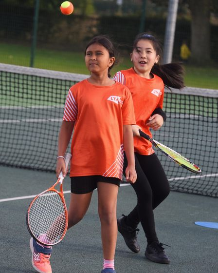 Concentrating hard, Sanaya, eight, left, and Joyce, eight, during the tennis coaching at the Norwich