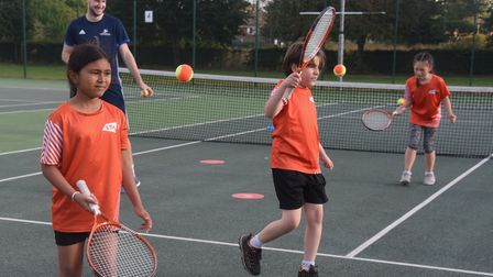 Children enjoying the tennis with coach Alex McNaughton, at the Norwich Parks Tennis Club at Eaton