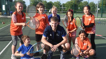 Coach Alex McNaughton with the children at the Norwich Parks Tennis Club at Eaton Park. From left, b