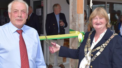 Councillor Caroline Mott, the Mayor of West Devon, cuts the ribbon with club chairman Nick Rogers