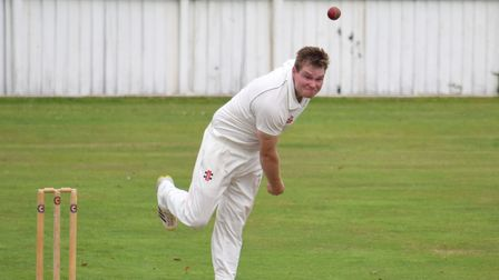Hatherleigh's Paul Heard on the way to a four-wicket haul against the President's XI