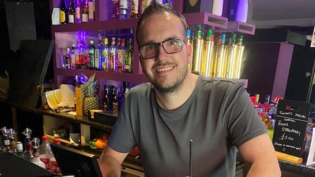 Andre Smith, owner of Cans 'N' Cocktails bar on Norwich's Prince of Wales Road with StopTopps anti-drink spiking measure