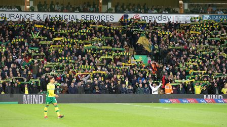 The home fans raise their scarves before the Sky Bet Championship match at Carrow Road, NorwichPic