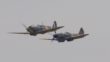 Spitfire pair displaying at IWM Duxford's Flying Days: The Fighters event.