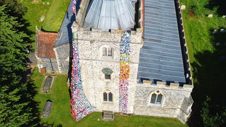 A drone shot of the amazing Barley Flower Tower atSt Margaret of Antioch Church.