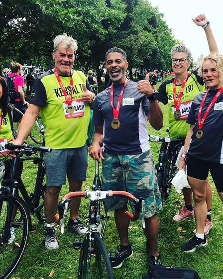 Kensal Rise cyclists celebrate with their medals.