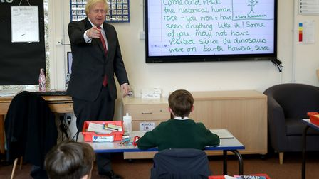 Prime Minister Boris Johnson joins a socially distanced lesson during a visit to Bovingdon Primary S