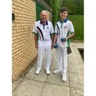 Grandfather and grandson bowlers
