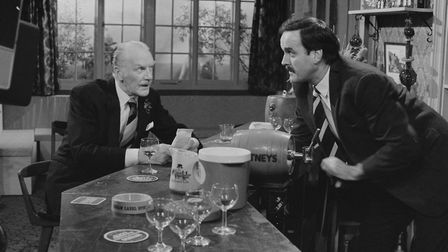 Actors Ballard Berkeley (left) and John Cleese in a scene from episode 'Communication Problems' of t