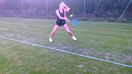 Bethan Fothergill playing tennis