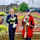 Romford MP Andrew Rosindell and Havering mayor John Mylod prepare to lay flowers outside Havering Town Hall