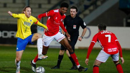 Asa Hall, Captain of Torquay United battles for the ball with Kyle Hudlin of Solihull Moors