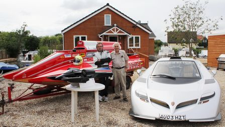 AlanSabberton his dad Peter with the house, car, speedboat and model, all of which he built.