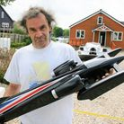 AlanSabberton with a scale model of his hydroplane, ready for testing.