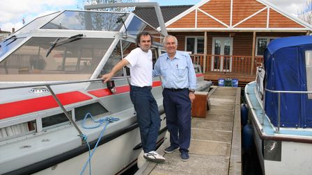 AlanSabberton with his father, Peter, by the cruiser and house he built.