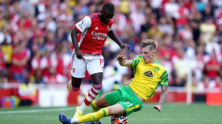 Norwich City's on loan Manchester United full back Brandon Williams snaps into a tackle on Arsenal's