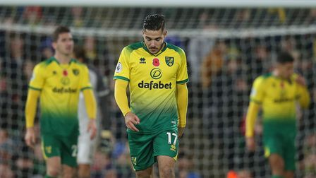 The Norwich players look dejected after conceding their side's 2nd goal during the Premier League