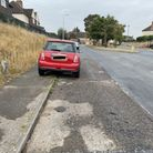 The parked Mini has prevented part of the road being resurfaced