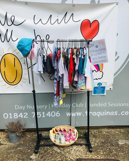 Pictured is a clothes rail outside of Traquinas Childcare where parents and families can donate items or take what they need.