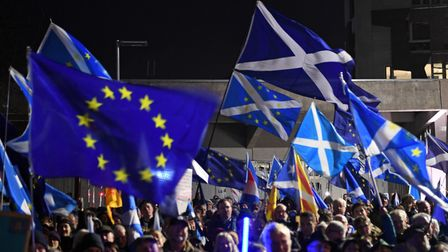Saltires and European Union flags flutter in the breeze during a protest by anti-Brexit activists in Edinburgh, Scotland