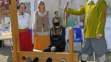Members of the public were able to try out the stocks on St Neots Market Square.