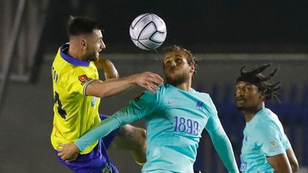 Torquay United player Joe Lewis in the air with Solihull Moors player Danny Newton during the Vanara