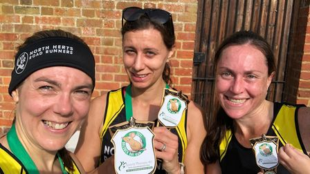Paula Holm, Tracy Pitcairn and Rhia Botha of North Herts Road Runners at the end of the Baldock Rat Run.