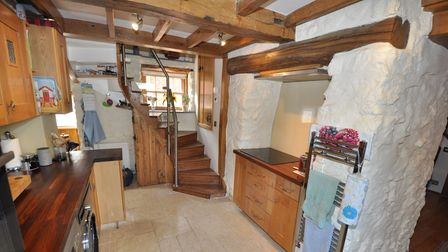 Stairs from the kitchen lead to a master bedroom with ensuite wet room