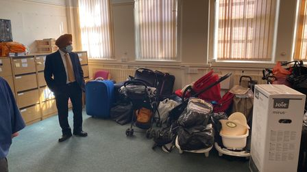 Council leader Jas Athwal looking at the donations made by the Redbridge public