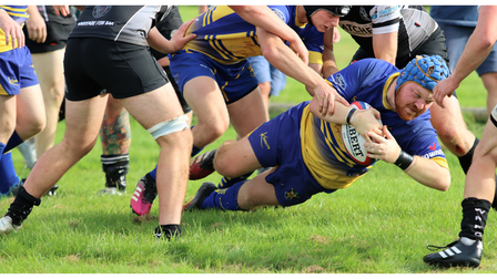 Clevedon RFC's Jack Crew goes over for the visitors third try at Winscombe RFC.